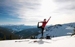 yoga-woman-doing-yoga-in-snow-620-large