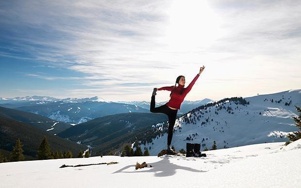 yoga-woman-doing-yoga-in-snow-620-large